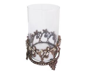 Portavelas de cristal sobre un soporte de metal envejecido con flores de nácar