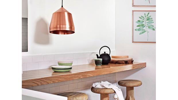 Cocina en verde y cobre
