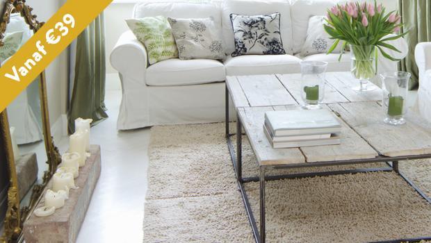 Toveren met tapijten